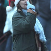 "Newbury:Music teacher Lori Peterson directs the Newbury Elemetary School  choir in ""Rudolph the Red Nose Reindeer""  at the annual tree lighting on the Upper Green sunday..photo by Jim Vaiknoras/Newburyport Daily News. Sunday December 7, 2008"