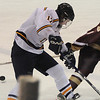 Peabody:Newburyport's William Eiserman knocks the puck away from Lynnfield's John Lee Saturday in Peabody.photo by Jim Vaiknoras.Newburyport Daily News. Saturday December 27, 2008