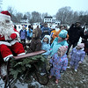 Newbury: Santa greets kids at the annual tree lighting on the Upper Green sunday..photo by Jim Vaiknoras/Newburyport Daily News. Sunday December 7, 2008