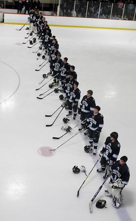 Newburyport:The Triton High school hockey team stands for the national anthem before  their game with Newburyport at the Graf Rink in Newburyport Saturday night.<br />  Photo by Jim Vaiknoras/Newburyport Daily News. Saturday December 13, 2008