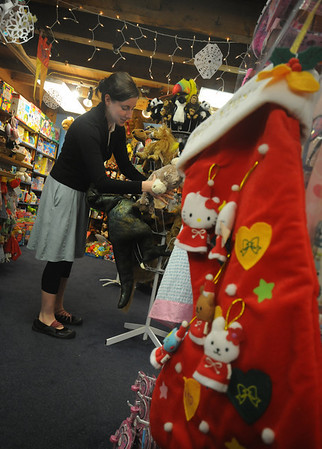 Newburyport:Marcie Bilodeau, an employee at the Dragons Nest, arrainges puppets at the store Friday. photo by Jim Vaiknoras/Newburyport Daily News.Friday December, 26, 2008
