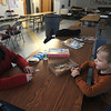 Amesbury: Joshua Bourgeois, 6, and his siter Tyler, 12, make a Simpson's puzzle at Amesbury Middle School. Their house on Sparhawk lost power during Friday's storm and they are staying with their family at the Red Cross shelter set up at the school.<br /> photo by Jim Vaiknoras/Newburyport Daily News. Saturday December 13, 2008