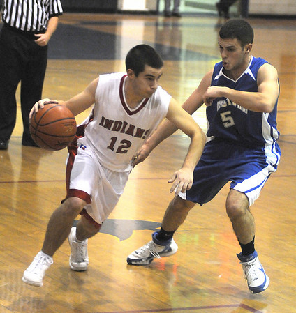Winthrop:Amesbury's William Medvitz drives on Georgetown's Kyle McKay during their basketball  game Saturday at Winthrop High in the annual Christmas Tournament.photo by Jim Vaiknoras.Newburyport Daily News. Saturday December 27, 2008