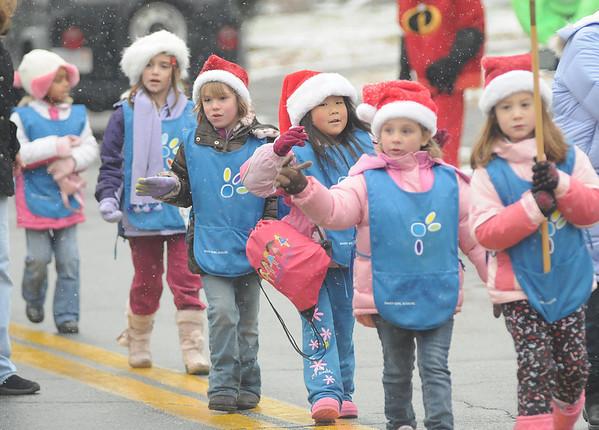 Merrimac:Girls from Groveland Daisies troop 62108 make their way through the snow in the annual Merrimac Santa Parade.photo by Jim Vaiknoras/Newburyport Daily News. Sunday December 7, 2008