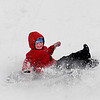 Newburyport:Sam Mollineaux, 4, of Newburyport wipes out while sledding at  March's Hill in Newburyport Saturday.photo by Jim Vaiknoras/Newburyport Daily News. Saturday December 20, 2008