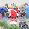 Newburyport: A large Christmas mouse from the book The Polar Express greet travelers at the Newburyport MBTA station. The event raised money for the Imaculate Conception School. photo by Jim Vaiknoras/Newburyport Daily News . Saturday December 6, 2008