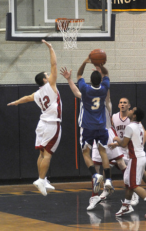 Winthrop:Amesbury's William Medvitz can't get to the jump shot of Georgetown'sTyran Harrigan during their basketball  game Saturday at Winthrop High in the annual Christmas Tournament.photo by Jim Vaiknoras.Newburyport Daily News. Saturday December 27, 2008