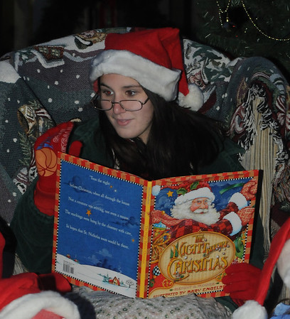 Amesbury:Ellie Esposito reads 'the night before Christmas' during the Amesbury Santa Parade and Tree Lighting Saturday afternoon. photo by Jim Vaiknoras/Newburyport Daily News. Saturday December 6, 2008