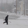 Salisbury: A man dashes across Salisbury Beach Center with a shovel as the weekend's snows continue Sunday.photo by Jim Vaiknoras/Newburyport Daily News. Saturday December 20, 2008