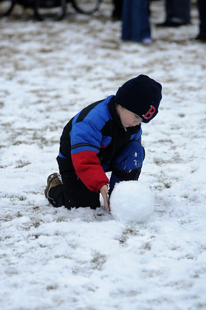 Newbury: Holden Van Etten , 5, makes a snowman as he waits for Santa  at the annual tree lighting on the Upper Green sunday..photo by Jim Vaiknoras/Newburyport Daily News. Sunday December 7, 2008