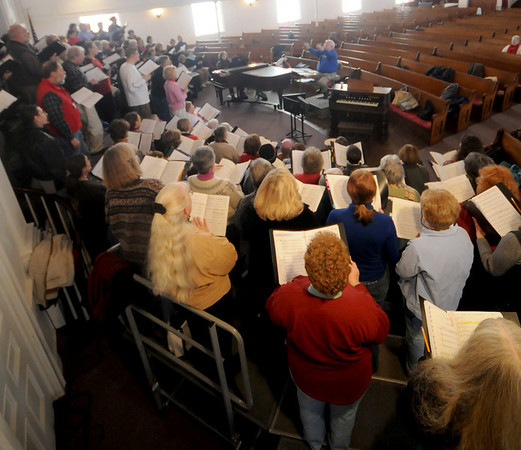 Newburyport Choral Society Director Gerald Weale conducts a rehearsal at the Belleville Church. Photo by Jim Vaiknoras/Newburyport Daily News.Saturday December, 6, 2008