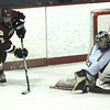 Peabody:Newburyport's Kyle McElroy takes a shot on Lynnfield's Craig Cataldo Saturday in Peabody.photo by Jim Vaiknoras.Newburyport Daily News. Saturday December 27, 2008