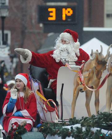 Merrimac:Santa waves to the crowd as he makes his way through the snow in the annual Merrimac Santa Parade.photo by Jim Vaiknoras/Newburyport Daily News. Sunday December 7, 2008