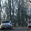 Amesbury: A worker repairs wires Saturday along Kimball Road in Amesbury.<br /> photo by Jim Vaiknoras/Newburyport Daily News. Saturday December 13, 2008