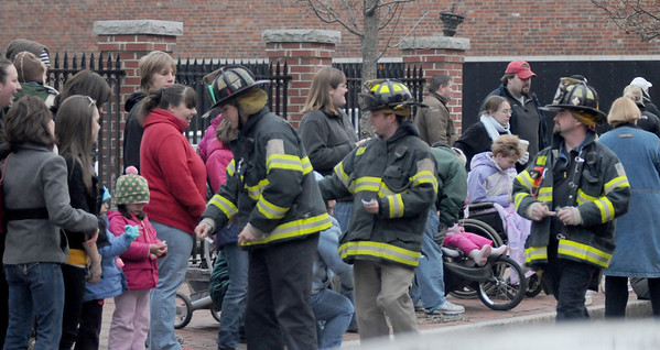 Amesbury:Amesbury Firefighters give out candy at the Amesbury Santa Parade and Tree Lighting Saturday afternoon. photo by Jim Vaiknoras/Newburyport Daily News. Saturday December 6, 2008