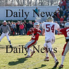 Amesbury: Amesbury quarterback Jared Flannigan (16) drops back to pass as Newburyport's Shea Quill (54) bears down on him. Photo by Ben Laing/Newburyport Daily News Thursday November 27, 2008.