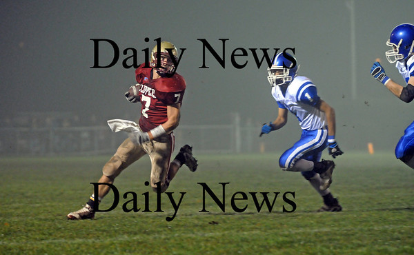 Newburyport: Kyle Leblanc (7), rushes around the end for the Clippers last night while being pursued by a pair of Georgetown defenders. Newburyport won in thrilling fashion, defeating the Royals 27-26 at NHS. Photo by Ben Laing/Newburyport Daily News Friday November 14, 2008.