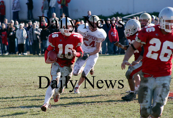 Amesbury: Indians quarterback Jared Flannigan (16) sweeps around the outside during Thursday's game against Newburyport. Photo by Ben Laing/Newburyport Daily News Thursday November 27, 2008.