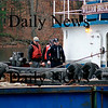 Amesbury: An Amesbury police officer boards the barge that hit the Hines Bridge. Photo by Ben Laing/Newburyport Daily News Thursday November 13, 2008.