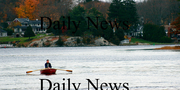 Amesbury: A lone boater rows down the Merrimac near Point Shore in Amesbury Thursday afternoon. Photo by Ben Laing/Newburyport Daily News Thursday November 13, 2008.