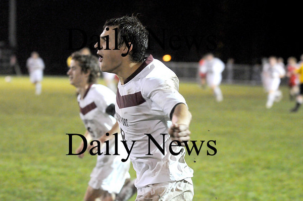 Newburyport: Senior captain Thayer Adsit (8) celbrates as the final whistle blows following the Clippers 4-0 defeat of Marblehead. Newburyport now advances to the next round of the state tournament. Photo by Ben Laing/Newburyport Daily News Friday November 7, 2008.