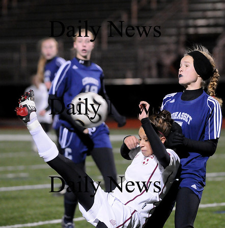 Lynn: Newburyport's Micaela Hogan kicks the ball over her head while Cohasset's Mackenzie Hart (7) try to defend her. Photo by Ben Laing/Newburyport Daily News Tuesday November 18, 2008.