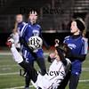Lynn: Newburyport's Micaela Hogan kicks the ball over her head while Cohasset's Mackenzie Hart (7) try to defend her. Photo by Ben Laing/Newburyport Daily News Tuesday November 18, 2008.
