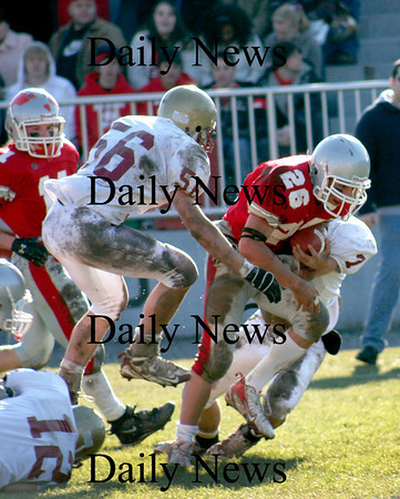 Amesbury: Amesbury running back Jesse Burrell (26) is dragged down by Newburyport's Kyle LeBlanc (7) and Dean Cataldo (56) during Thursdays victory over the Clippers, 22-7. Photo by Ben Laing/Newburyport Daily News Thursday November 27, 2008.