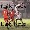 Newburyport: Newburyport senior Tyler Stotz heads a ball past Marbleheads goalkeeper, giving the Clippers a 1-0 early in the second half. The Clippers never let up, finishing off their opponedt 4-0 to advance to the next round of the state tournament. Photo by Ben Laing/Newburyport Daily News Friday November 7, 2008.