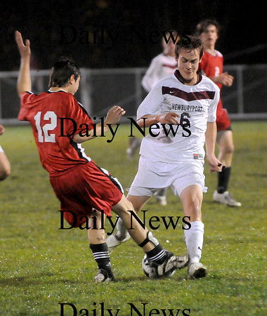 Newburyport: Clipper's midfielder Paul Cendron (6) takes the ball from Marblehead's Max Sherman (12) during Friday night's soccer game at NHS. Newburyport defeated Marblehead 4-0 and advance to the next round of the state tournament. Photo by Ben Laing/Newburyport Daily News Friday November 7, 2008.