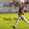 Amesbury: Indians running back Kevin Johnstone (21) skips across the goal line with out a Hamilton-Wenham defender in sight for Amesbury's first score early in the first quarter of Friday nights game. Photo by Ben Laing/Newburyport Daily News Friday November 7, 2008.