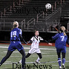 Lynn: Micaela Hogan (3) of Newburyport and two Cohasset defenders all watch the ball during Tuesday night's Eastern Mass. State Final game in Lynn. Newburyport won in double overtime, 1-0. Photo by Ben Laing/Newburyport Daily News Tuesday November 18, 2008.