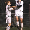 Newburyport: Senior Tom Dwyer (26) is congradulated by teammate Charlie Knowlton (4) after scoring a goal at the end of Newburyport's 4-0 defeat of Marblehead Friday night at World War Memorial Stadium. Photo by Ben Laing/Newburyport Daily News Friday November 7, 2008.