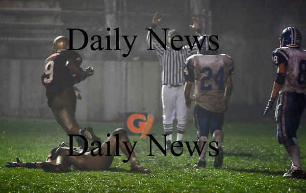 Newburyport: The referee signals touchdown as Andrew Sokol (9) runs to celebrate with teammates after pulling down a game winning hailmary against Georgetown. Newburyport won the game 27-26. Photo by Ben Laing/Newburyport Daily News Friday November 14, 2008.