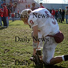 Amesbury: Newburyport's Andrew Sokol (9) takes knee at midfield following the Clipper's 22-7 defeat at Amesbury. Photo by Ben Laing/Newburyport Daily News Thursday November 27, 2008.