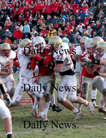 Amesbury: Amesbury quarterback Jared Flannigan (16) is sandwhiched between two Clipper defenders during Thursday's win over Newburyport. Photo by Ben Laing/Newburyport Daily News Thursday November 27, 2008.