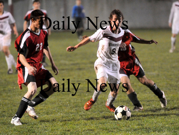 Newburyport: Newburyport captain, Tom Svirsky (9), breaks through the Marblehead defense during Friday night's game at NHS. The Clippers won the game, 4-0, advancing to the next round of the state tournament. Photo by Ben Laing/Newburyport Daily News Friday November 7, 2008.