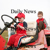 "Newbury: Dalton Cronin, 4, left, and Will Pflaum, 3, both of Newburyport, play on a tractor at the Plum Island Airport Tuesday morning. The two boys were part of the Spencer-Pierce-Little Farm's ""Farm Friends"" program, which visited the airfield. Photo by Ben Laing/Staff Photo"