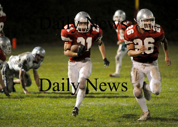 Amesbury: Amesbury's Kevin Johnston (21) returns a kickoff deep into Generals' territory, lead by fellow running back  Jesse Burrell (26). The Indians took on Hamilton-Wenham at Landry Stadium Friday night.  Photo by Ben Laing/Newburyport Daily News Friday November 7, 2008.