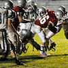 Amesbury: Indians running back Jesse Burrell (26) carries a group of Generals defenders with him as Amesbury took on Hamilton-Wenham at Landry Stadium Friday night. Photo by Ben Laing/Newburyport Daily News Friday November 7, 2008.