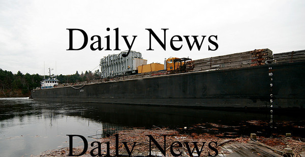 Amesbury: A new transformer arrives in Amesbury on a barge from Virginia. The barge hit the Hines bridge on its way up the river to Larry's Marina, causing the bridge to be damaged and closed to traffic. Photo by Ben Laing/Newburyport Daily News Thursday November 13, 2008.