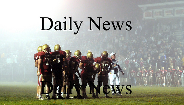 Newburyport: The Clippers huddle up whlie driving towards an eventual touchdown in Friday night's game against Georgetown. Photo by Ben Laing/Newburyport Daily News Friday November 14, 2008.