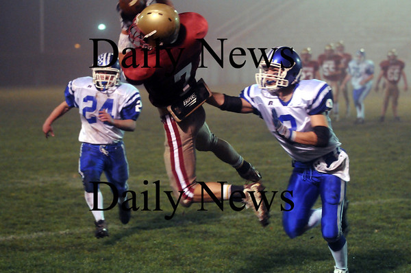 Newburyport: Newburyport's Kyle Leblanc (7) reels in a pass while covered by Georgetown's Anthony Conte (8) during Friday's game at NHS. Photo by Ben Laing/Newburyport Daily News Friday November 14, 2008.