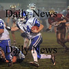 Newburyport: Georegtown quarterback Joe Esposito (14) follows his blocker as he manuevers through the Newburyport defense during Friday nights game at NHS. The Clippers pulled out a win in the last minute, defeating the Royals 27-26. Photo by Ben Laing/Newburyport Daily News Friday November 14, 2008.