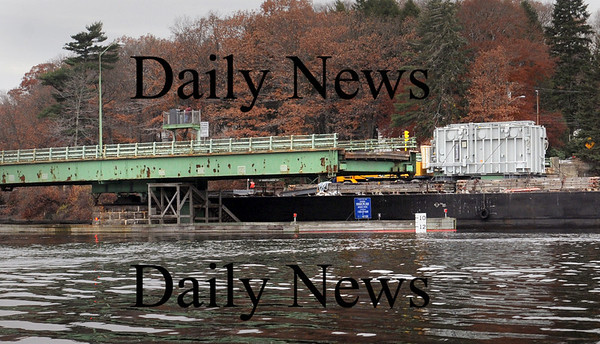 Newburyport:<br /> The barge continues up the Merrimack River seconds after hitting a part of the HInes Bridge which is closed indefinitely.<br /> Photo by Bryan Eaton/Newburyport Daily News Thursday, November 13, 2008