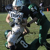 West Newbury:<br /> Pentucket's Jordan Silva (8) and C.J. Lataille take down Triton's Jedd Hutchins.<br /> Photo by Bryan Eaton/Newburyport Daily News Thursday, November 27, 2008