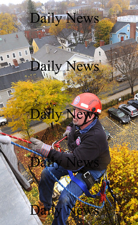 Newburyport:<br /> Newburyport firefigher Paul Gouldthorpe begins rappelling down from the top of the Sullivan Building in Newburyport during a rescue exercise being taught by the Massachusetts Firefighters Academy.<br /> Photo by Bryan Eaton/Newburyport Daily News Thursday, November 06, 2008