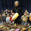 Amesbury:<br /> Amesbury Elementary School teacher's aide Milly Sanford, who is a member of the Wampanoag tribe, shows off a drum along with other American Indian artifacts to students at the school. The talk was part of the studies the students have engaged in about  life in colonial America.<br /> Photo by Bryan Eaton/Newburyport Daily News Monday, November 17, 2008