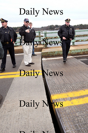 """Newburyport:<br /> Newburyport police officers check out the stuck Hines Bridge which was hit by a barge carrying an electrical transformer. From left, Lt. Mark Murray, Det. Harrison L. """"Mickey"""" Whitney, Jr., Marshall Thomas Howard and Sgt. Steve Chaisson.<br /> Photo by Bryan Eaton/Newburyport Daily News Thursday, November 13, 2008"""