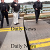 "Newburyport:<br /> Newburyport police officers check out the stuck Hines Bridge which was hit by a barge carrying an electrical transformer. From left, Lt. Mark Murray, Det. Harrison L. ""Mickey"" Whitney, Jr., Marshall Thomas Howard and Sgt. Steve Chaisson.<br /> Photo by Bryan Eaton/Newburyport Daily News Thursday, November 13, 2008"